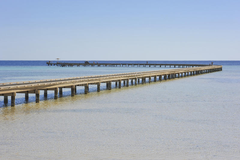 Long Jetty Over Coral Reef Royalty Free Stock Images