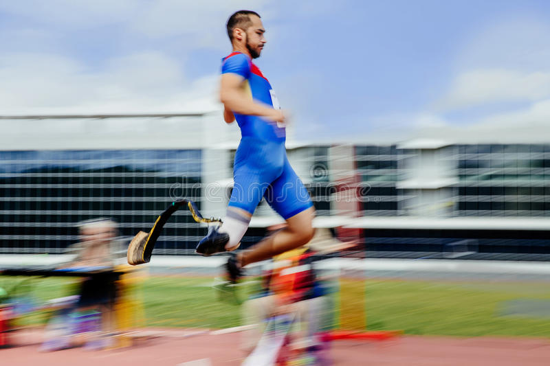 Long jump athlete paralympic disabled. Blurred motion long jump athlete paralympic disabled royalty free stock photo
