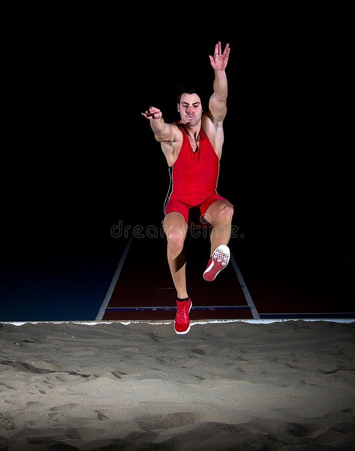 Long jump athlete. Training indoor royalty free stock photos