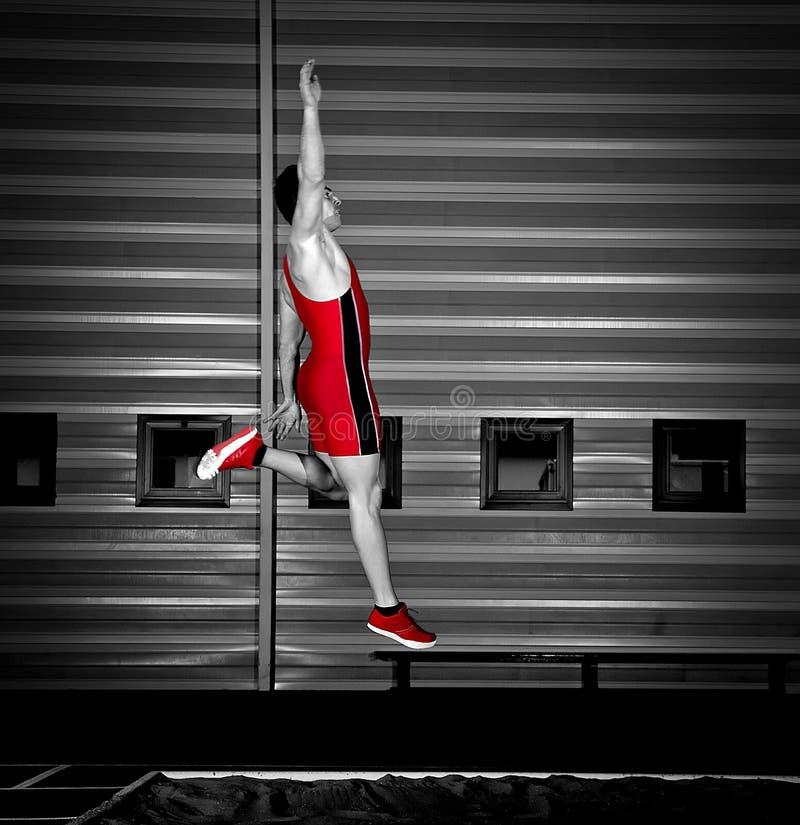 Long jump athlete. Training indoor stock photos
