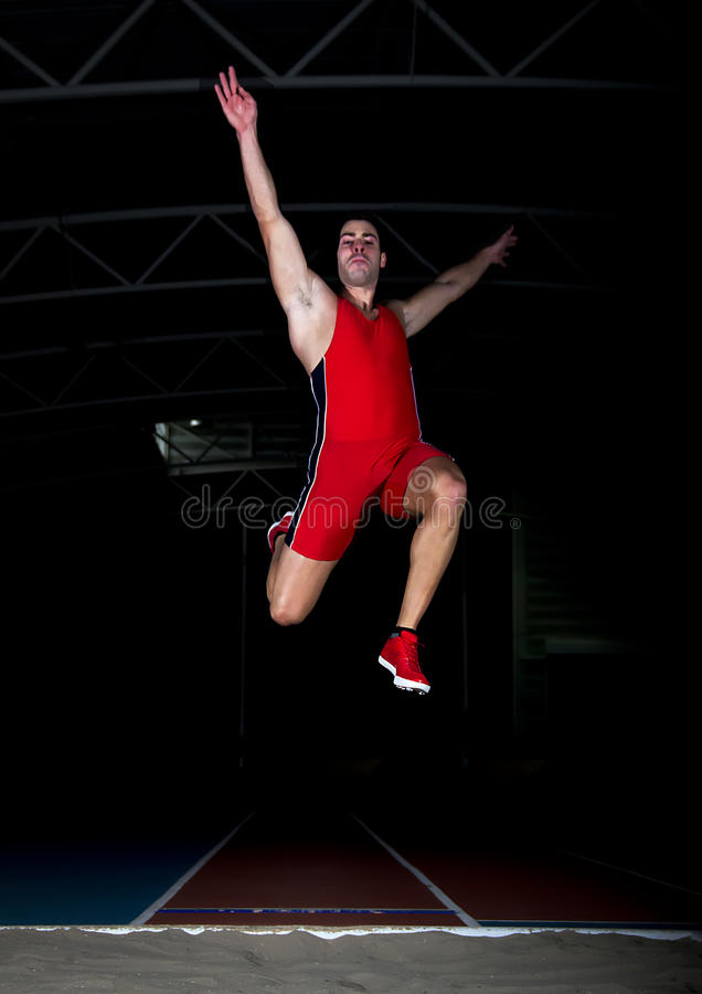 Long jump athlete. Training indoor royalty free stock photography