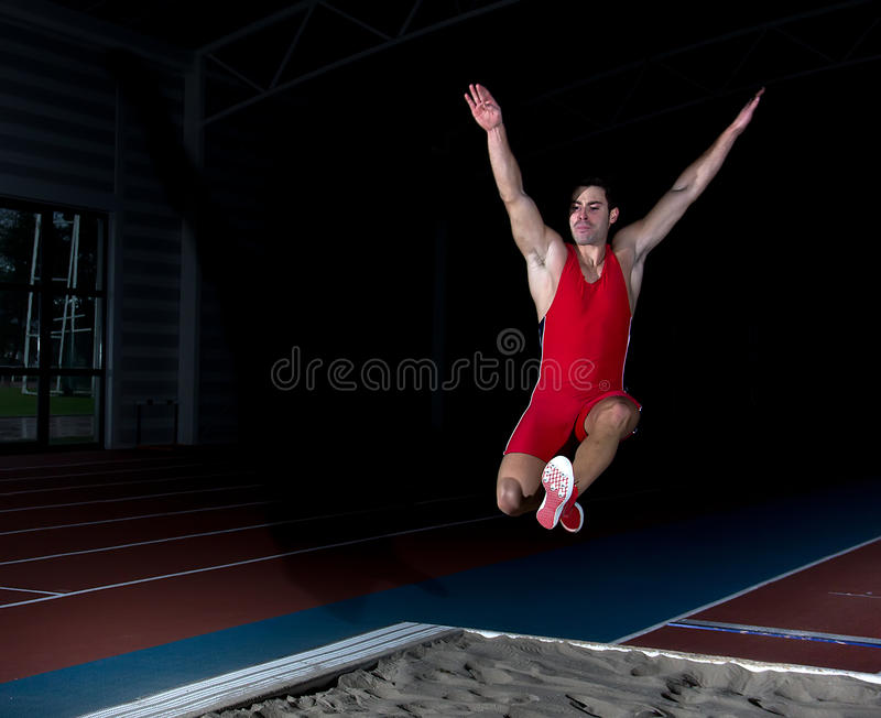Long jump athlete. Training indoor stock images
