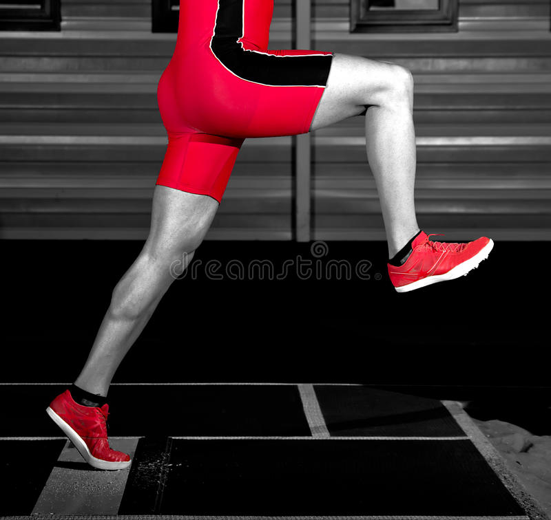 Long jump athlete. Training indoor royalty free stock images