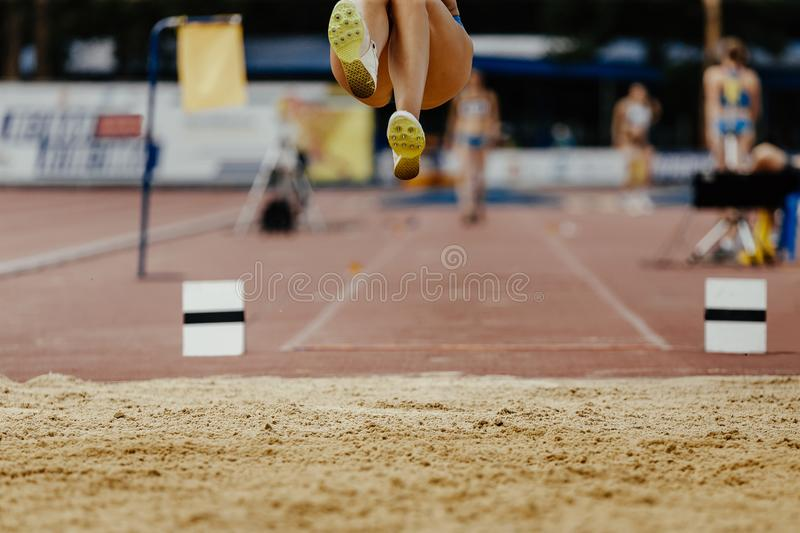 Long jump woman legs athlete. Jumper competition athletics stock images