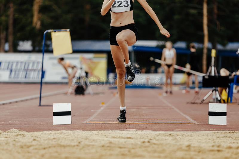 Long jump women athlete. Jumper take off board royalty free stock photography