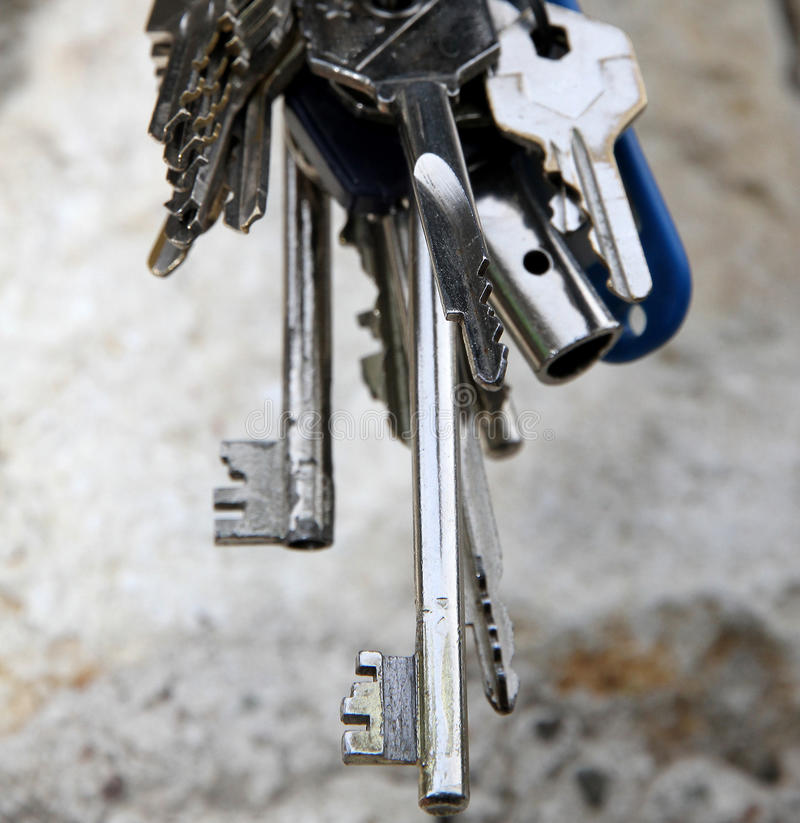 Long key and other keys to open the door lock royalty free stock images