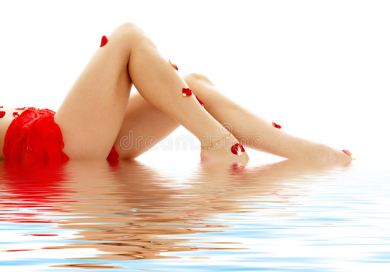 Long legs lady in water stock image
