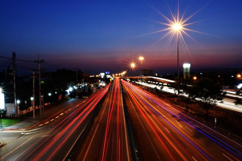 Long light of car on road. On evening time for car and transportation concept stock photos