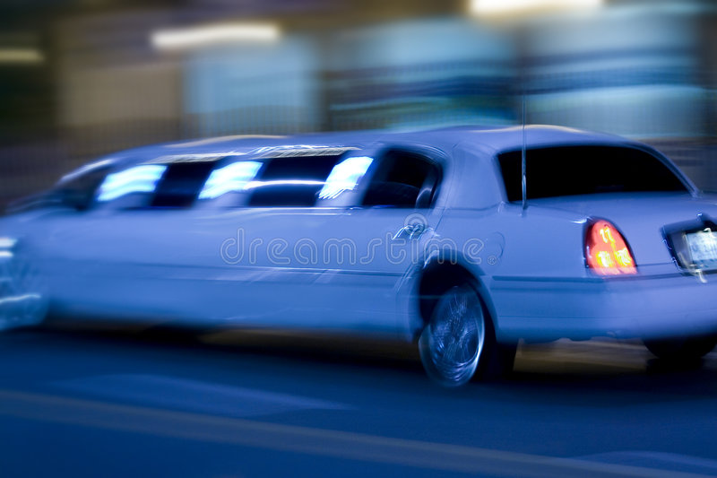 Long limo. Moving fast on the road royalty free stock photo