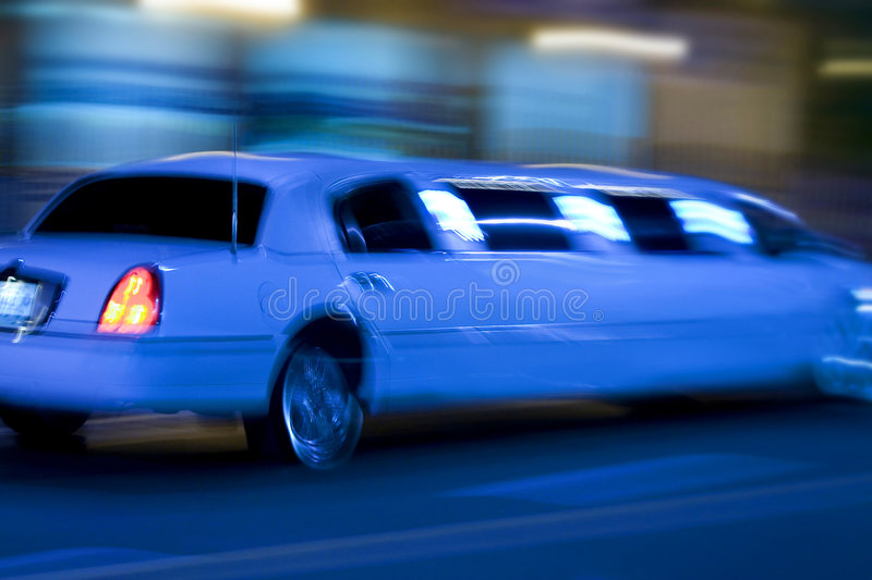 Long limo. Moving fast blue blur stock photo