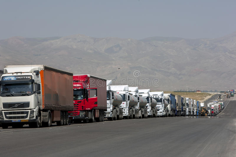 A long line of semi-trailers and trucks wait on the Turkish border with Iran. stock image
