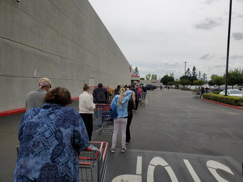 Long lines at store due to Coronavirus royalty free stock photography