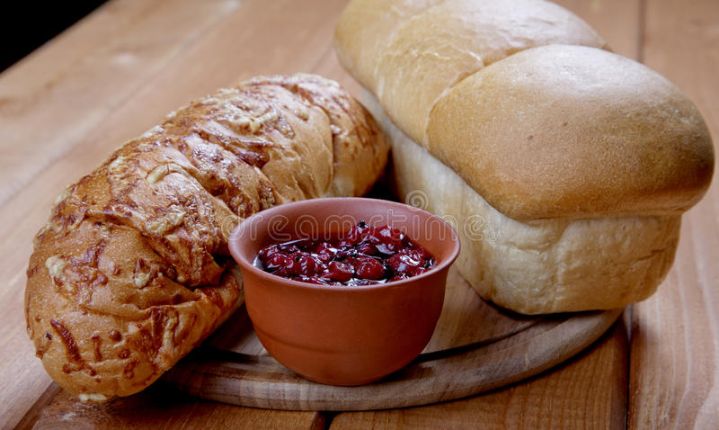 Long loaf of bread and jam royalty free stock photography