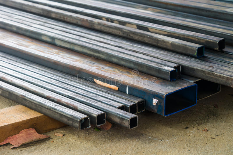 Long metal beams at construction site stock images
