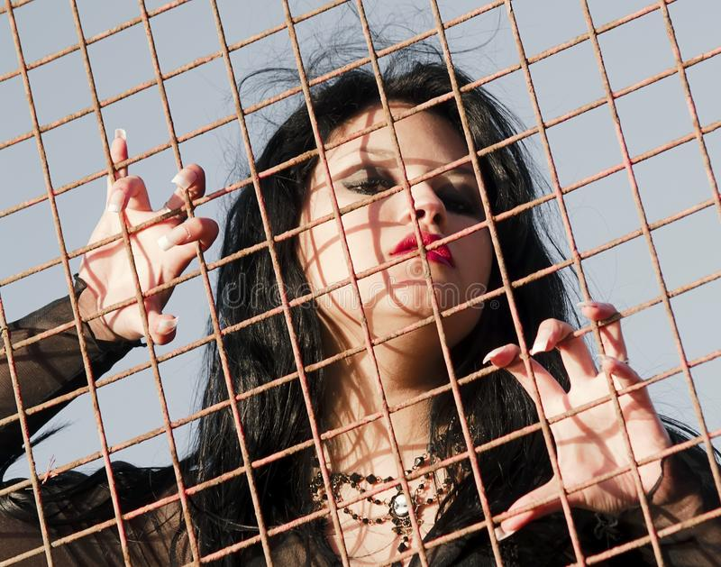 Long nailed woman in jail. Gothic young woman posing outdoors at the seacoast of Valparaiso royalty free stock images