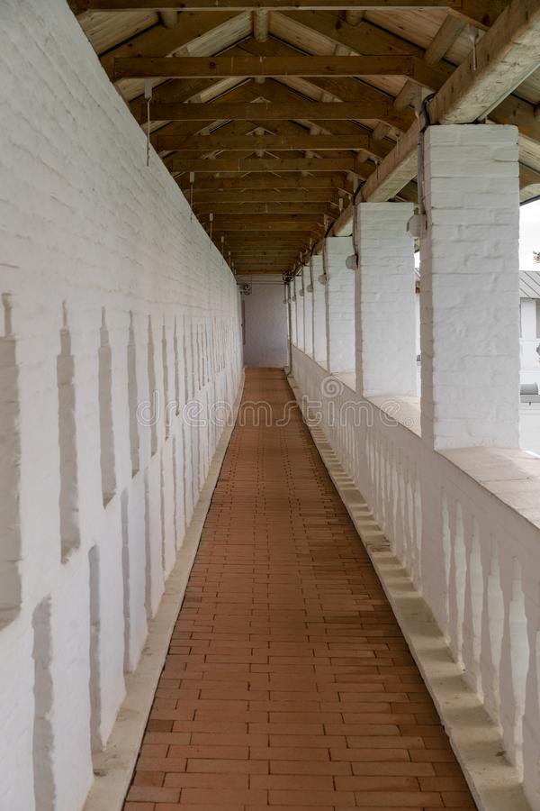 Long narrow corridor in an old building stock image