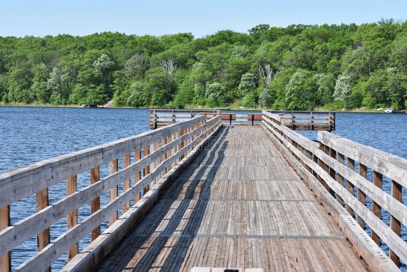 Long Narrow Fishing Pier on the Lake stock image