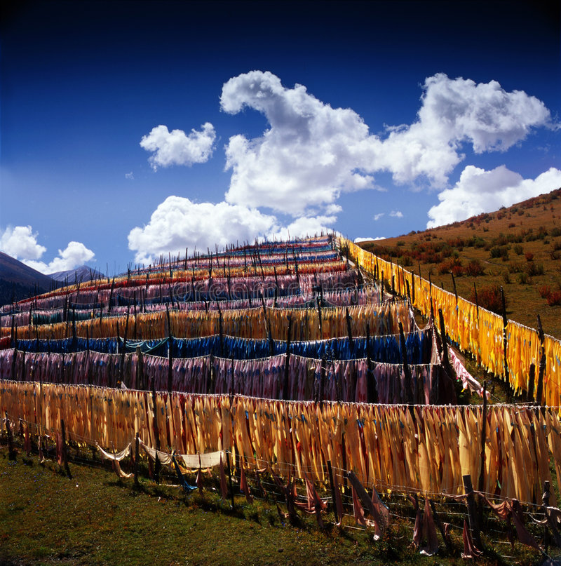 Long narrow flags in Tibet. Can be seen everywhere in Tibet linked to the Peak Pass, along the River Bank and the riverside temples, and so on around the long stock photo