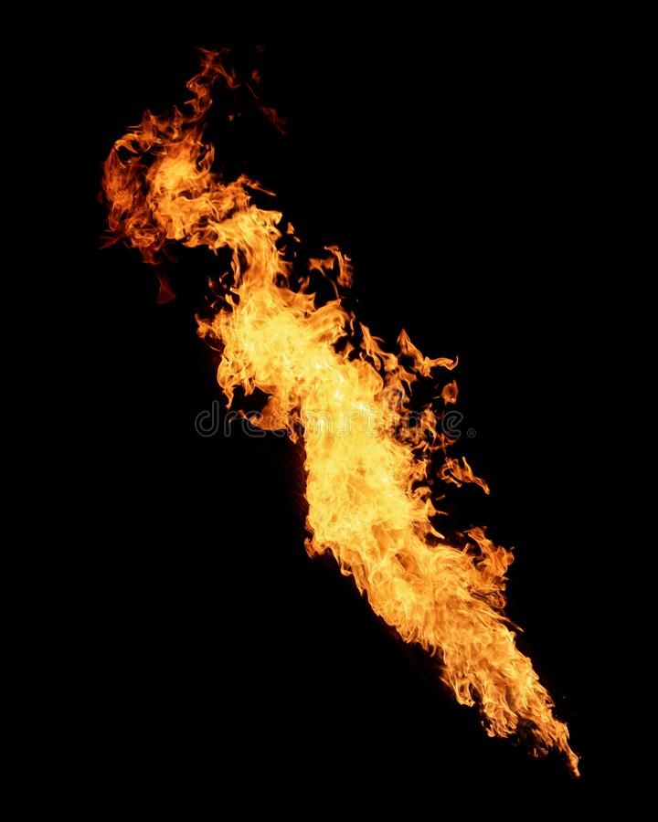 Long narrow flame isolated on black royalty free stock images