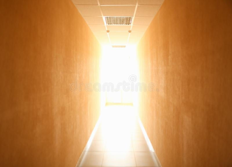 Long narrow tunnel with light in the end stock photos