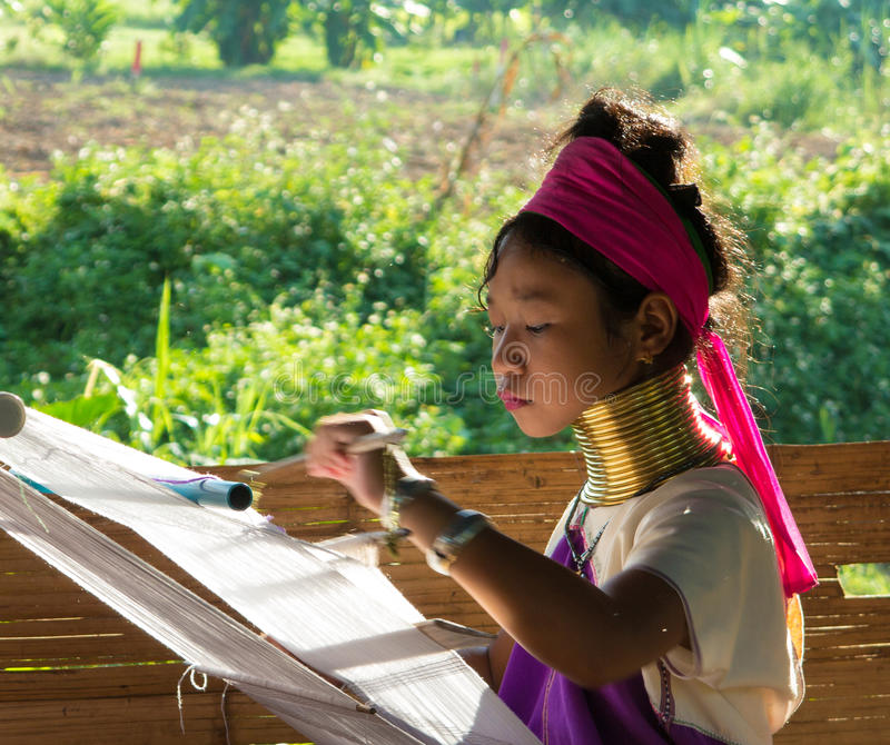 Long neck tribe woman weaving royalty free stock image