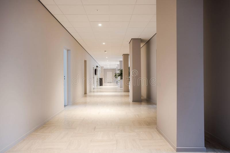 Long office hallway modern design, empty and clean interior royalty free stock photography