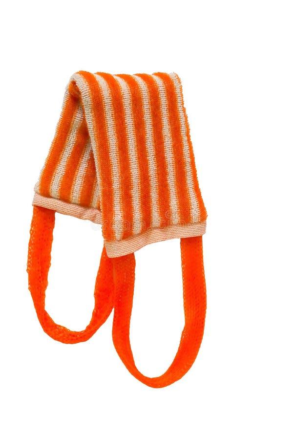 Long orange sponge on a white background. Striped sponge on a white background stock photography