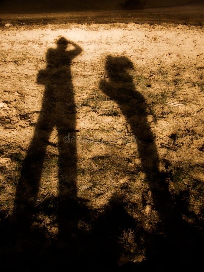 Long people shadows stock photos