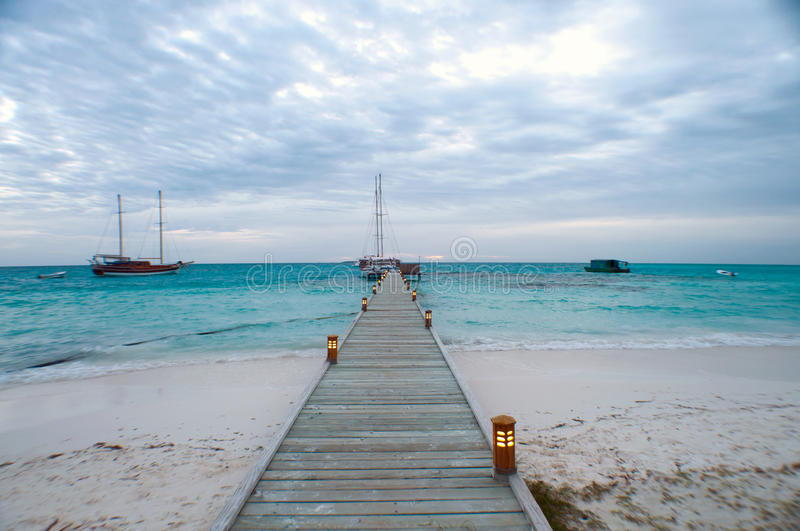 Long pier and boats royalty free stock image