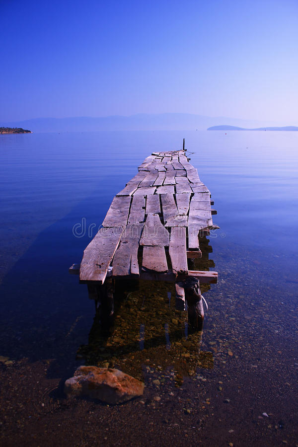 A long pier landscape with a blue calm sea stock image