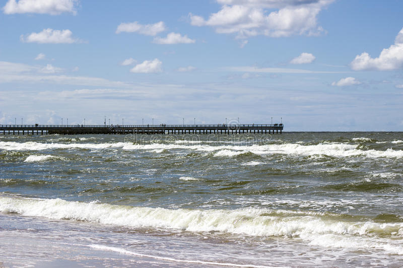 Long pier in the popular resort of Palanga, Lithuania. Long pier in the popular resort of Palanga in Lithuania royalty free stock images