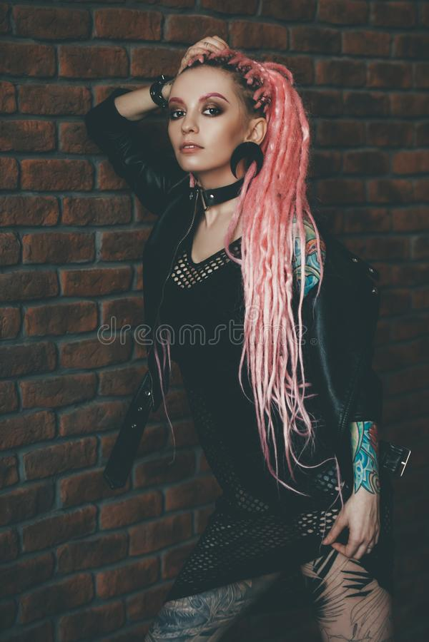 Long pink dreadlocks stock photography