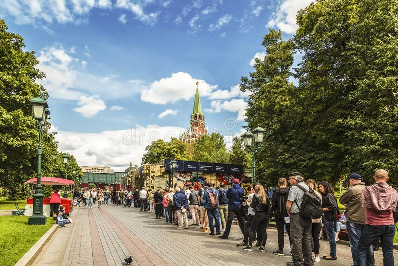 A long queue of tourists in the Alexander garden for tickets to visit the Moscow Kremlin. Moscow stock image