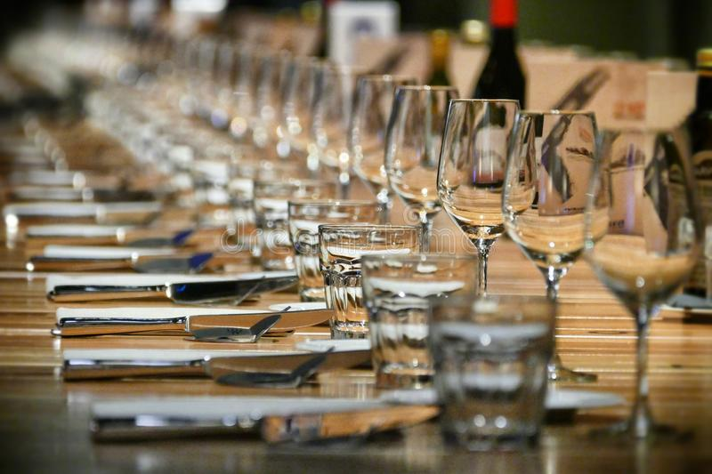 Long raw of restaurant table setting royalty free stock photos