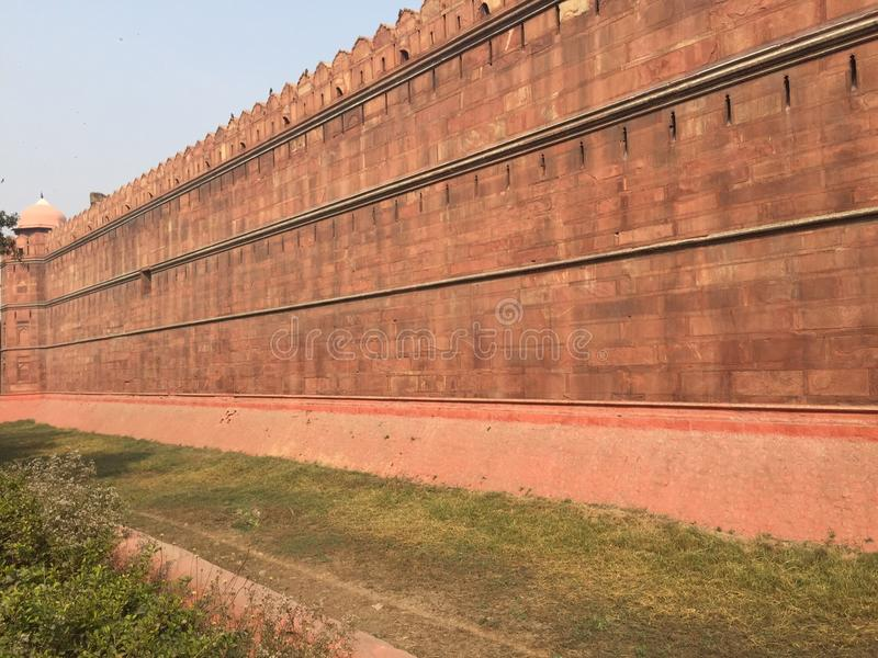 Long red coloured wall (monument - Red Fort) stock image