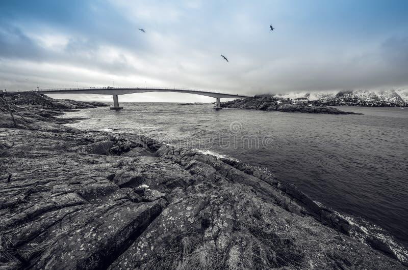 Long road bridge. Beautiful Norway landscape. Lofoten islands. Black-white photo with blue sky. Long road bridge. Beautiful Norway landscape. Lofoten islands royalty free stock photo