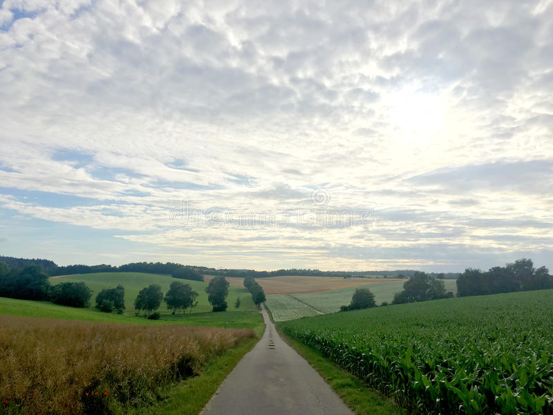 A long road in a landscape of German countryside in Baden-Wurrtemberg, with carriage royalty free stock photography