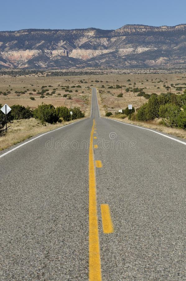 Long road in the New Mexico desert stock images