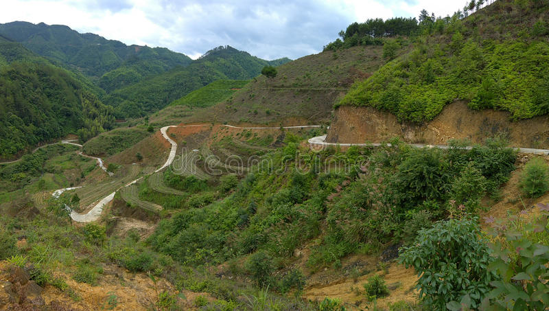 Long road snaking up a mountain royalty free stock photo