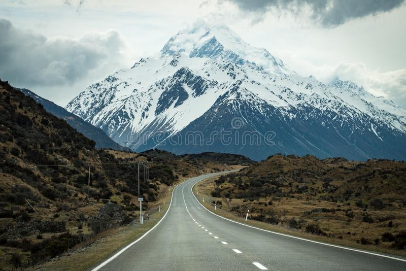 The long road to Mount Cook 3,764 metres the highest mountains in South Island of New Zealand. Aoraki/Mount Cook National Park is a rugged land of ice and rock stock photo