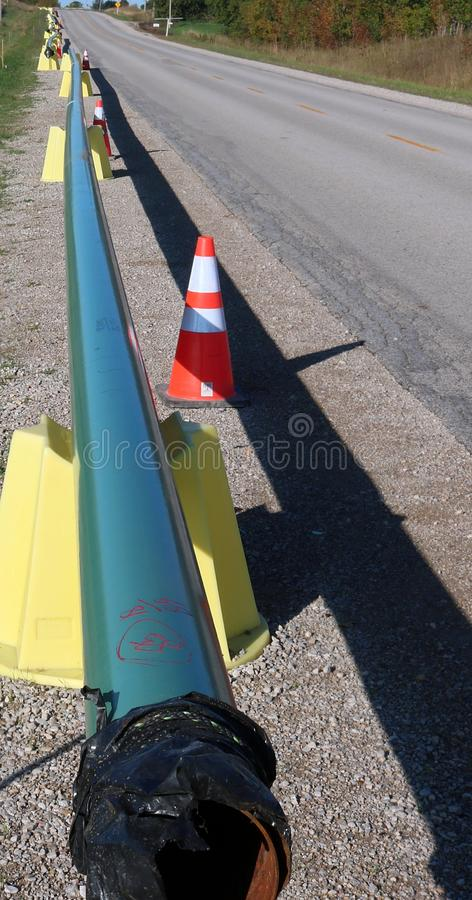 Long row of pipe on shoulder of the road read for instarllation for gasline royalty free stock photography