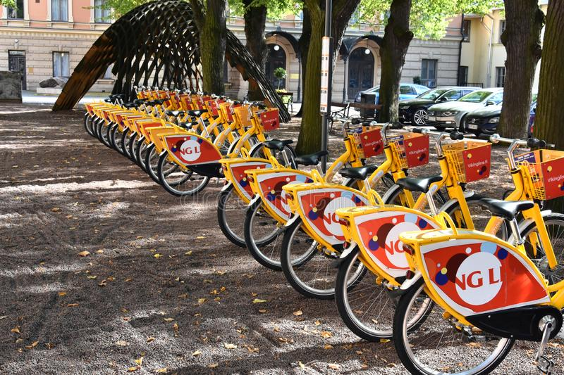Turku finland rental bikes in the centre of the city. A long row of red and yellow bikes at the bike rental station 8in Turku, Finland stock photo