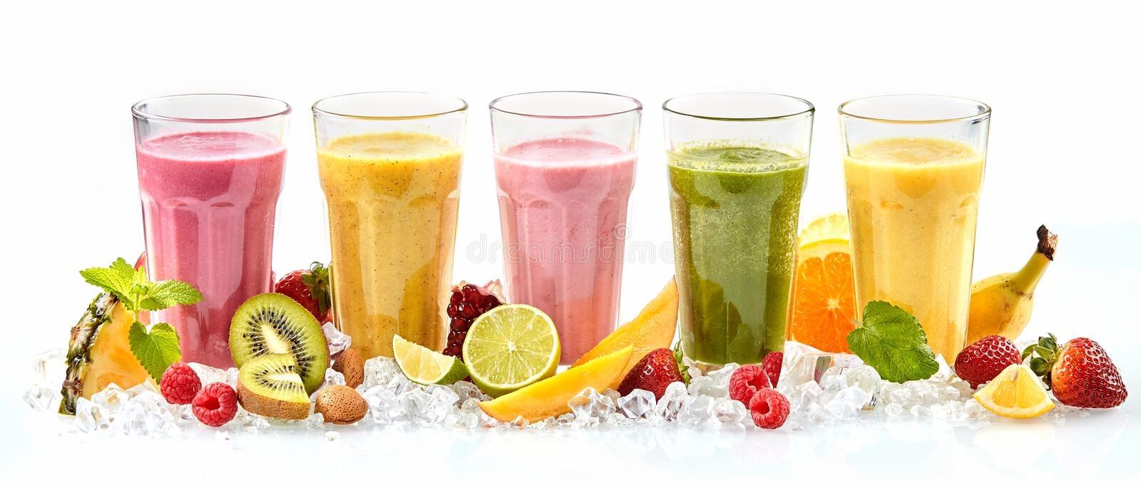 Long row of tropical fruit drinks in tall glasses royalty free stock photos