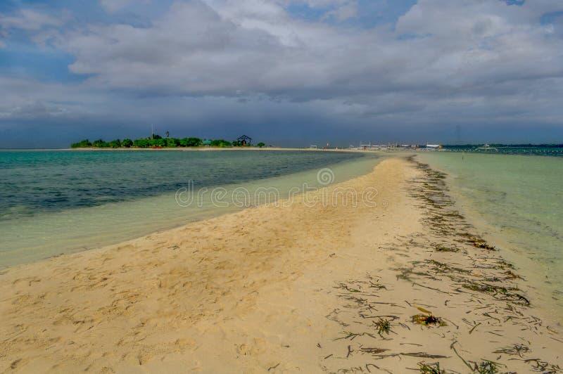 A long sandbar in an Island stock photos