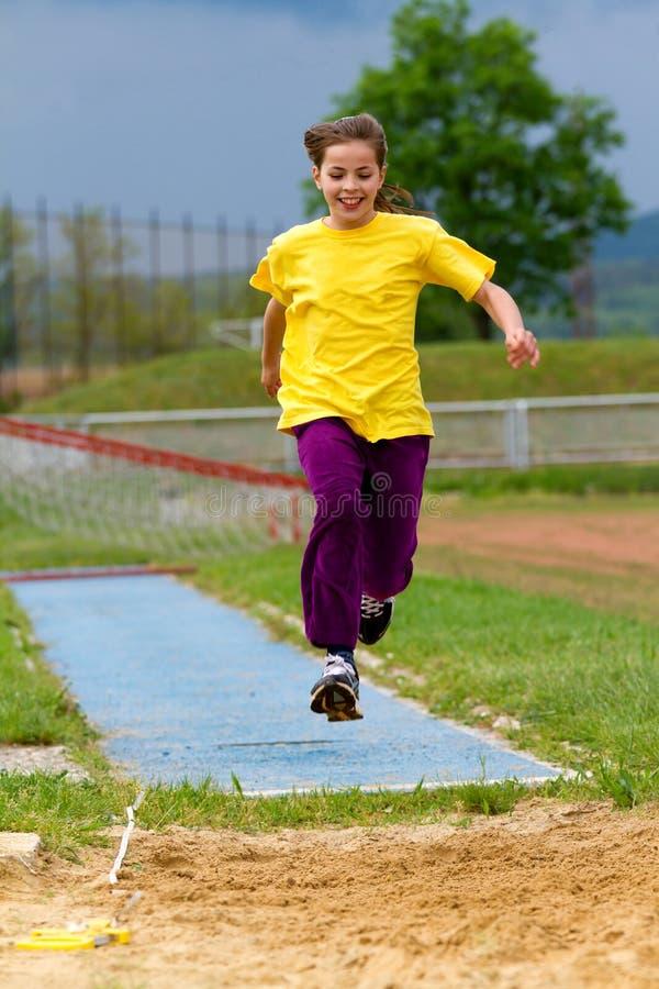 Long saut photo libre de droits