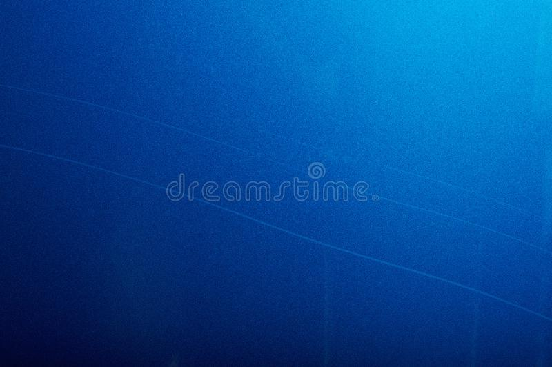 Long scratch on blue car paint royalty free stock photo