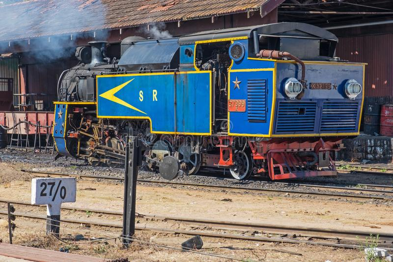Long serving Indian steam train in Tamil Nadu. Coonoor, India - March 4, 2018: Steam engine still used to haul passenger trains on the section of the Nilgiri royalty free stock photo