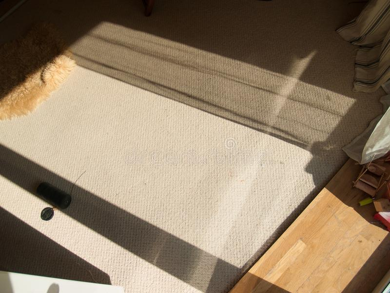 Long shadows on bright carpet stock photography