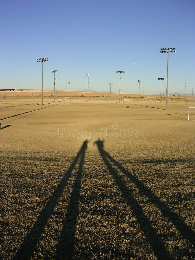 Long shadows on dead field stock images