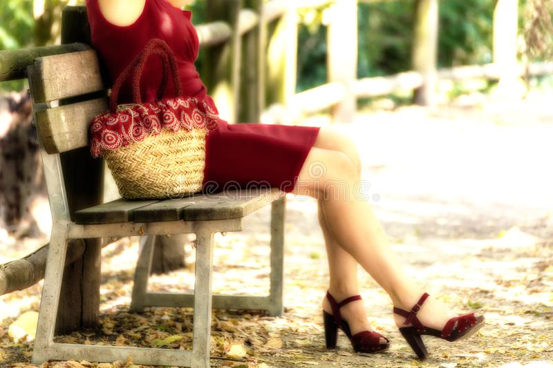 Legs of woman waiting on a bench stock images